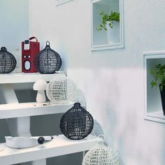 For an interesting effect in the garden, line modern lattice lanterns up a row of steps and keep the scheme monochrome for a striking contrast against the green of the plants.    Lanterns from Also Home