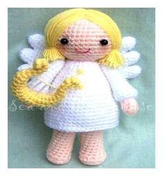 El ángel encantador con su arpa. El muñeco terminado es 9 de alto.    Nivel de habilidad de ganchillo: fácil / intermedio. Requiere el