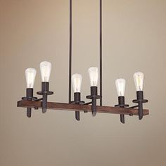Hang this chandelier above a kitchen island or long dining table for an industrial inspired look.