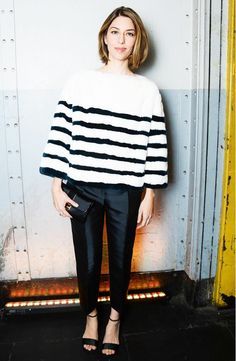 Sofia Coppola in a fuzzy striped sweater, sharp trousers and strappy sandals