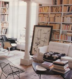 Living rooms that double as libraries are probably my favorite thing. Who wouldn't love a living room that's as cozy & friendly as a library? Plus, what a cool chair!