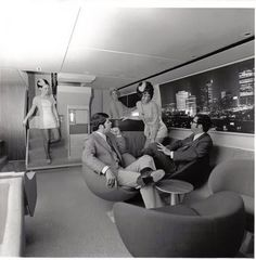 Vintage airplane lounge in the 1960s. (makes the Southwest of today look like a 2 bit horse and buggy show)