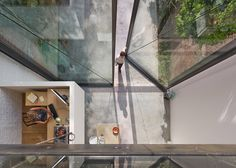 A pair of glass doors, weighing almost four tonnes and measuring six metres in height, pivot out towards the garden of this renovated Antwerp home.  http://designgallerist.com/blog/ #artGallery #home #ideas #lighting #trendy #designgalleries #contemporarydesigners #moderndesign #installation #limitededition #designfairs #design #interviews #Rare #products #unique #furniture #creators #inspiration #fineart #galleries