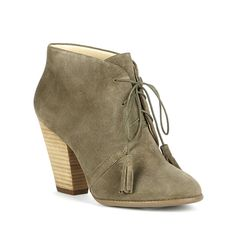 Lace-up ankle booties in army green suede with fun, on-trend tassels and a stacked heel