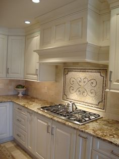 Saint cecelia granite, crema marfil subway tile backsplash and island top