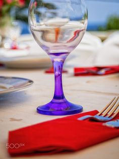 Wineglasses and decoration at a dinner table.