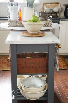 DIY: How to Make a Kitchen Island from an IKEA Cart - awesome project uses an inexpensive cart and a piece of marble for the top to create a unique and practical island. Oliver and Rust: Ikea Hacking in the Kitchen for more counter space Ikea Kitchen Cart, Portable Kitchen Island, Diy Kitchen Island, Kitchen Rug, Living Room Kitchen, Kitchen Decor, Ikea Cart, Kitchen Trolley, Kitchens