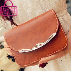 Bag with nice silver ornament.                     Design:shoulder bag,handbag,messenger bag     Materials:pu leather     Features