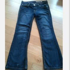 """DKNY DONNA KARAN BLUE BOOTCUT STRETCH JEANS! 27 32 These Great jeans stretch & are the perfect easy wear pair. They're a beautiful rich indigo blue dye w/ Fabulous distressing throughout!  Love the YELLOW STITCHING THROUGHOUT with the BLUE YARN SWISH DESIGN on back pockets & leather logo patch. Style Times Square.    Size: 27 S, orig inseam 29.5"""". Fits many due to lycra! Low Waist 32 1/2""""; rise 7 1/2""""; At bottom zipper 38"""", add'l 4"""" stretch; Boot Cut 9 1/2"""". Excellent condition! 1"""" vertical…"""