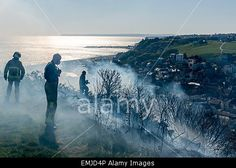 Hastings. East Sussex. UK. 21st April 2015. Firefighters tackling what is thought to be a gorse and grassland fire on the East Hill, #Hastings © Parkerphotography / Alamy Live News
