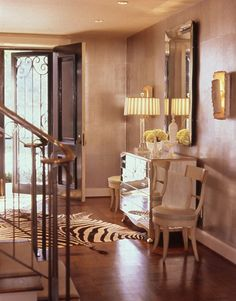 A magnificent entryway!  Key ingredients:  Mirror...Chest...and a great lamp!