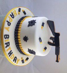8 inch Vanilla Fondant Gun Cake with Gun Cookie Cake Topper - $75.00