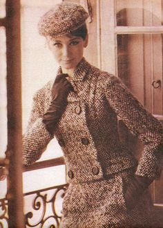 Model is wearing a Christian Dior suit and photographed by Richard Avedon.  French Vogue,August 1962.