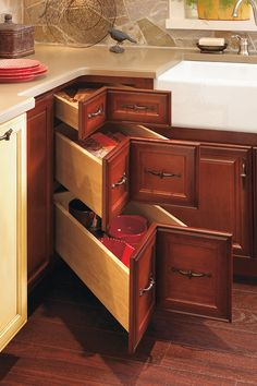 The angled drawers of this corner drawer cabinet provide a unique way to maximize storage capacity in corner areas.