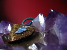 Blue Kyanite orgonite pendant for chakra attunement by Orgoknights, $33.00