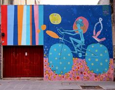 Street Artist Creates Colorful, Whimsical Murals Of People Cycling - DesignTAXI.com