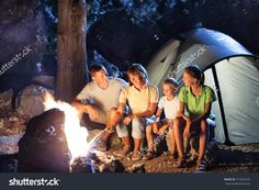 Happy family at camping with campfire at night
