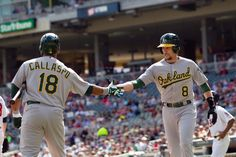 CrowdCam Hot Shot: Oakland Athletics shortstop Jed Lowrie gets congratulated by infielder Alberto Callaspo in the third inning against the Minnesota Twins at Target Field. Photo by Brad Rempel