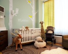 Pretty yellow curtains in this woodlands themed #nursery!