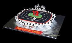 race car bday cupcake cake by Simply Sweets, via Flickr - colors of this track in a number 3 shape with cars toppers racing