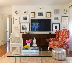 living room. beautiful credenza, ikat chair, gallery wall