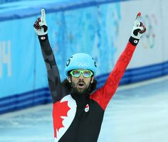 Charles Hamelin of Canada wins the gold medal in the men's short track 1500m Final during the Sochi 2014 Olympic Games, February 10, 2014.