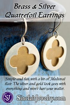 """These earrings are inspired by Medieval Gothic architecture. Each one is made from two discs, one silver and one brass. The top disc has a quatrefoil """"window"""" cutout like what you can see in churches. The ear hooks are sterling silver"""