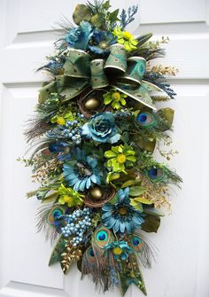 Peacock Swag (Wreath Alternative) http://www.timelessfloralcreations.com/