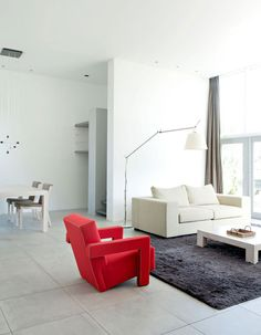 This bungalow originally designed by Gerrit Rietveld, has been remodelled by Utrecht based interior designer Remy Meijers. The bungalow is located in White Interior Design, Interior Design Living Room, Living Room Designs, Bungalow Living Rooms, Living Room Remodel, Bungalows, Red Room Decor, Turbulence Deco, Red Rooms