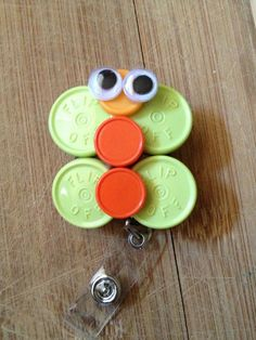 Oogle Eyes ID Badge Holder With Retractable Reel - Made From Flip Off Vial Caps via Etsy