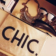 Chic glitter clutch This clutch is *stand out* & somehow neutral at the same time! gold glitter background (glitter does not rub off, this is smooth, shiny plastic feel) on front & back // black letters CHIC adorn this adorable bag // brand new never worn // zipper closure // fully lined // lightweight and durable... What else could a gal want?!  Take as a clutch for some serious day drinking (my fav brunch accessory!) OR travel with it on the go & at home as a cosmetics bag. Wipes clean…