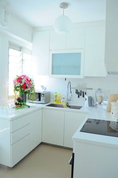 Contemporary Compact Kitchen with a drying rack above the sink to not cloud counter space.