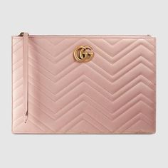 Shop the GG Marmont matelassé leather pouch by Gucci. The GG Marmont pouch  has a softly structured shape and a top zip closure. The hardware is  inspired by ... 3d731faecb7