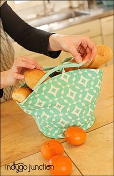 "Indygo Junction's Bakery Baskets pattern ($9.99) includes two decorative yet functional baskets for bread storage & serving. The honeycomb style allows warming pockets for each roll while the tote version ties up for larger loaves. Insulated batting keeps bread warm. Sizes: honeycomb: 11"" Diameter x 4"" H; tote: 12"" W x 8"" H Available as either e-pattern or print pattern. #digitalpattern #epattern"