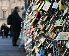 Locks of love- Paris --- people attach locks on a bridge and then throw the key into the water to symbolize eternal love