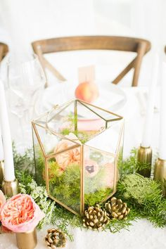 Rustic moss and flowers wedding centerpiece / http://www.deerpearlflowers.com/moss-decor-ideas-for-a-nature-wedding/2/