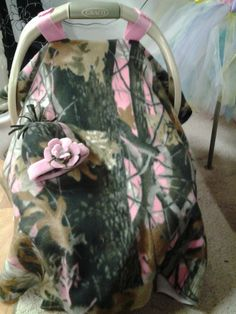 pink camo fleece car seat canopy with a boutique style hat and handmade flower