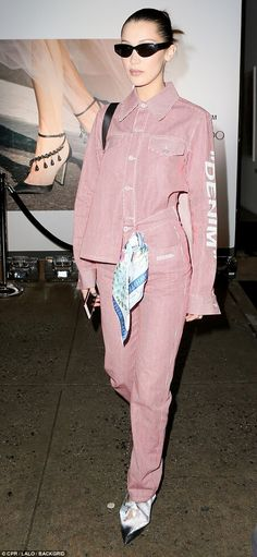 Suited and booted: Bella Hadid wowed in an all-pink striped ensemble as she arrived at the Jimmy Choo party on Sunday after a busy day at NYFW
