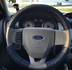 My paracord steering wheel! 100 feet of 550 rated black paracord with blue aaccent.
