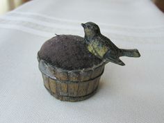 ANTIQUE LATE 1800'S EARLY 1900'S CAST METAL BIRD ON A BUSHEL BASKET PIN CUSHION | eBay