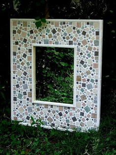 Decorative Mosaic Mirrors in the Garden Created from Ceramic Tiles, Glass and Hand made Concrete Leaves.