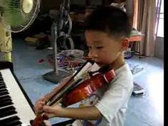 boy in Bangkok playing Doraemon Opening Theme Song in his first favorite part—See more of this young violinist #from_jadevt