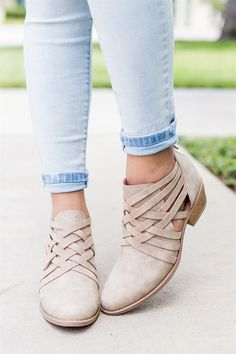 """Walk with a fashionable vengeance in these super cute ankle heel booties! Crafted with faux leather and features a 1.5"""" stacked heel, closed almond toe, backside zipper, and crisscross ankle strap holds."""
