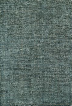 Toro Teal Premium Cut Viscose and Loop Pile Wool Rug | Abode and Company. Toro rugs are hand woven of premium cut pile viscose and loop pile wool in 7 rich colors.  They are warm and luxurious, with tonal yarn variations that allow each rug greater texture and softness.  These rugs blend easily into any setting.