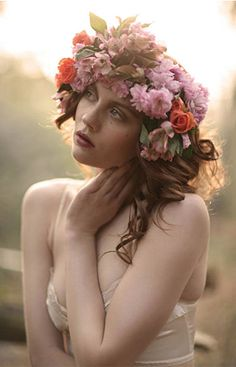 I LOVE this photo - and the colour and what I can see of the dress I love - I like the idea of flowers in the hair.. although I think maybe I wouldn't have THIS many..  but GORGEOUS photo - the lighting!!