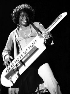 James Brown playin' keytar. Yes on so many levels.....wish I could have found one of his old songs.