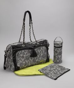 Out and about with Baby? This water-repellent diaper bag set is the perfect package for all those organizing needs. A zipper top keeps the top closed while a roomy interior offers three pockets and two elastic bottle holder loops. Featuring three exterior pockets, an insulated bottle bag, a zipper pouch and large changing pad, it ensures essentials stay safe, sanitary and on hand at all times.Plus, removable straps allow it to be hooked up to any stroller in a j...
