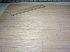 Scoring a doll house floor for varnishing or painting
