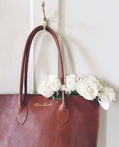 This is a beautiful warm brown tote bag. I like the finished straps- makes for a perfect work bag!