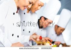 Asian Indonesian chef along with other cooks in restaurant or hotel kitchen cooking, finishing dish or plate for dessert - stock photo Hotel Kitchen, Photo Editing, Royalty Free Stock Photos, Restaurant, It Is Finished, Asian, Dishes, Cooking, Plate